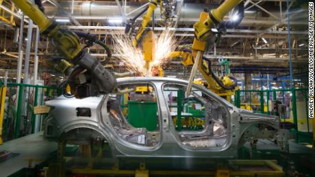 Robotic arms weld the frame of a Renault Captur crossover sport utility vehicle (SUV) in the weld shop inside the Renault SA automobile plant in Moscow, Russia, on Tuesday, May 28, 2019. A prospective deal proposed by Fiat Chrysler Automobiles NV to merge with Renault could create the world's third-biggest carmaker. Photographer: Andrey Rudakov/Bloomberg via Getty Images