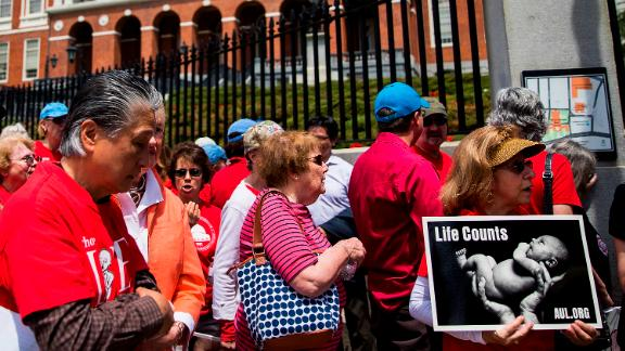Anti-abortion activists hold a rally outside the Massachusetts Statehouse in Boston on June 17, 2019.
