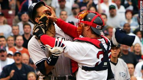BOSTON - JULY 24:  Alex Rodriguez #13 of the New York Yankees gets into a fight with catcher Jason Varitek #33 of the Boston Red Sox after Rodriguez was hit by a pitch in the third inning on July 24, 2004 at Fenway Park in Boston, Massachusetts.  (Photo by Ezra Shaw/Getty Images)