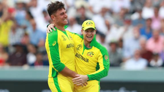 LONDON, ENGLAND - JUNE 25: Marcus Stoinis (L) celebrates with team mate Steve Smith after taking the wicket of Jos Buttler during the Group Stage match of the ICC Cricket World Cup 2019 between England and Australia at Lords on June 25, 2019 in London, England. (Photo by David Rogers/Getty Images)