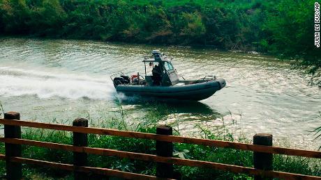 A U.S. Border Patrol boat navigates the Rio Grande near where the bodies of Oscar Alberto Martínez Ramírez and his daughter Valeria were found in Matamoros, Mexico, on June 24.