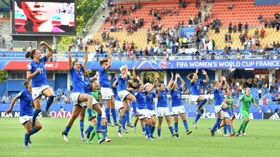 Italy's players celebrate reaching the quarterfinals. The first time the country has done so since 1991.