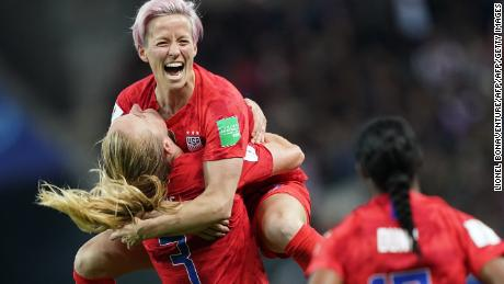 United States' midfielder Sam Mewis (L) celebrate with United States' forward Megan Rapinoe (C) after scoring a goal during the France 2019 Women's World Cup Group F football match between USA and Thailand, on June 11, 2019, at the Auguste-Delaune Stadium in Reims, eastern France. (Photo by Lionel BONAVENTURE / AFP)        (Photo credit should read LIONEL BONAVENTURE/AFP/Getty Images)