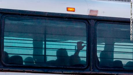 A bus transporting immigrants leaves a temporary facility at a US Border Patrol Station in Clint, Texas, on June 21, 2019. - Lawyers who were able to tour the facility under the Flores Settlement, which governs detention conditions for migrant children, said they witnessed inhumane conditions of overcrowding, and about 250 children being held over the limit of 72 hours, some saying they were there for weeks in overcrowded cells. (Photo by Paul Ratje / AFP)        (Photo credit should read PAUL RATJE/AFP/Getty Images)