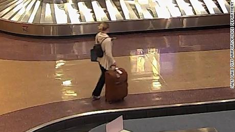 Lueck carries her luggage through Salt Lake City International Airport.