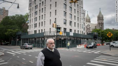 Guy Aiossa stands outside the new site for a SAGE building in Brooklyn.