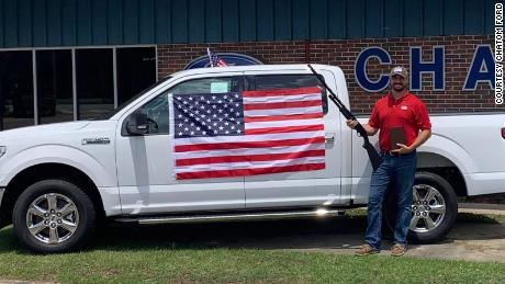 Chatom Ford in Alabama is giving away bibles, American flags and gift certificates for a shotgun to customers who purchase any new or used vehicle throughout July.