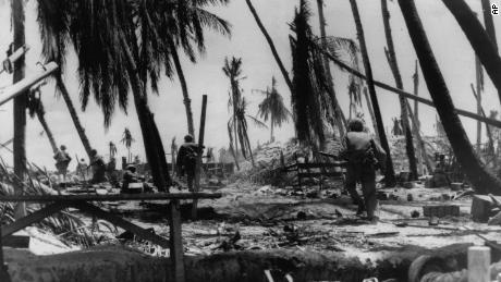 US Marines charge a hill on Tarawa in the early stages of the battle on the Japanese-held atoll in the Gilbert Islands.