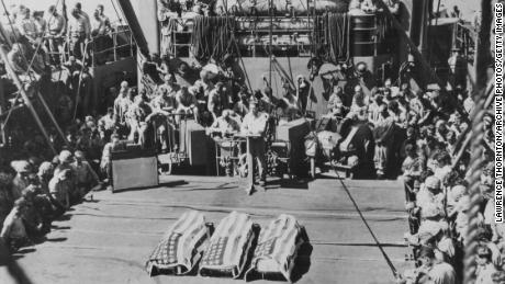 A funeral is held at sea for three US Marines killed in the Battle of Tarawa.