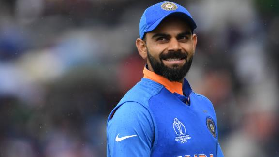 India's captain Virat Kohli looks on as rain falls during the 2019 Cricket World Cup group stage match between India and Pakistan at Old Trafford in Manchester, northwest England, on June 16, 2019. (Photo by Dibyangshu SARKAR / AFP) / RESTRICTED TO EDITORIAL USE        (Photo credit should read DIBYANGSHU SARKAR/AFP/Getty Images)
