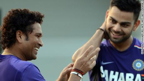 Tendulkar shares a light moment with Kohli during a training session in Mumbai on November 9, 2012.