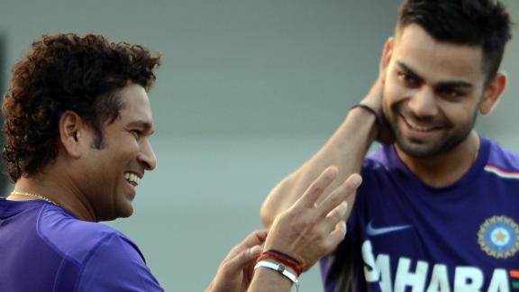 Tendulkar shares a light moment with Kohli during a training session in Mumbai on November 9, 2012.