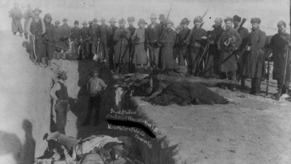US soldiers burying the Native Americans massacred at Wounded Knee in Wounded Knee, South Dakota.