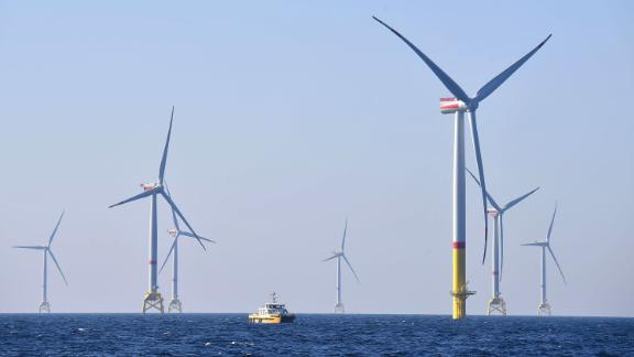 Wind turbines are pictured during the inauguration day of the Arkona wind park on April 16, 2019, in the Baltic Sea, northern Germany. (Photo by Tobias Schwarz/AFP/Getty Images)