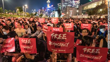 Protesters rally against the extradition bill ahead of the G20 summit.