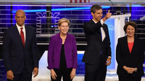 O'Rourke gives a thumbs-up before the start of the first Democratic debates in June 2019. With him, from left, are US Sens. Cory Booker, Elizabeth Warren and Amy Klobuchar.