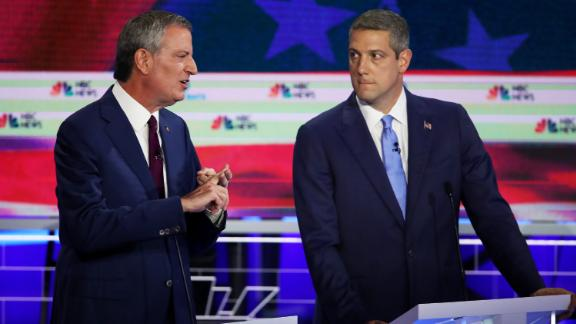 Ryan, right, looks at de Blasio as the New York mayor answers a question on Wednesday.
