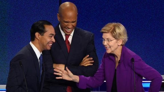 From left, Castro, Booker and Warren share a laugh during a commercial break on Wednesday.