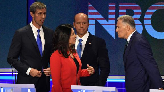 Gabbard speaks with Inslee during a commercial break Wednesday.
