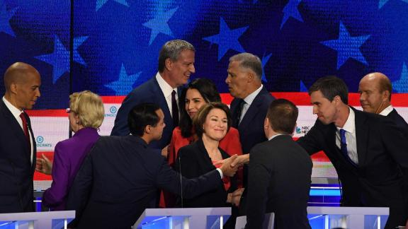 Candidates greet each other at the end of Wednesday