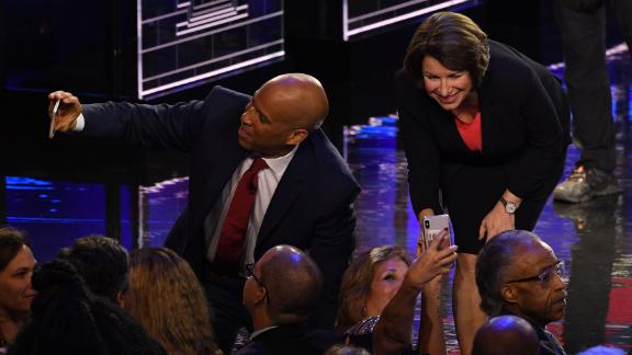 Booker and Klobuchar take selfies with supporters after Wednesday