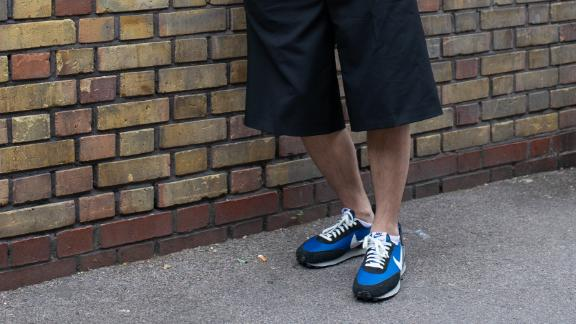 A guest at London Fashion Week wearing Undercover x Nike sneakers in London in June.