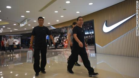 People walking out of a Nike store in Beijing last September.
