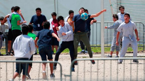 """FILE - In this April 19, 2019 file photo, Migrant children play soccer at the Homestead Temporary Shelter for Unaccompanied Children on Good Friday in Homestead, Fla. Immigrant advocates say the U.S. government is allowing migrant children at a Florida facility to languish in """"prison-like conditions"""" after crossing the U.S.-Mexico border instead of releasing them promptly to family as required by federal rules. A court filing Friday, May 31, 2019 revealed conditions inside the Homestead, Florida, facility that has become the nation's biggest location for detaining immigrant children. (AP Photo/Wilfredo Lee, File)"""