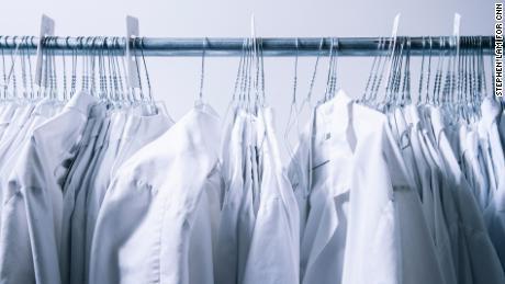 Lab coats hang inside the lab.