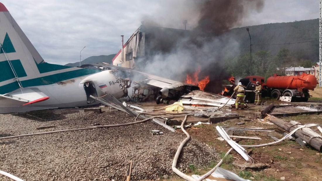 Two killed after Russian plane overshoots runway and bursts into flames