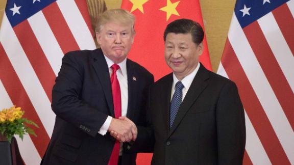 "US President Donald Trump (L) shakes hands with China's President Xi Jinping during a press conference at the Great Hall of the People in Beijing on November 9, 2017.  Donald Trump urged Chinese leader Xi Jinping to work ""hard"" and act fast to help resolve the North Korean nuclear crisis, during their meeting in Beijing Thursday, warning that ""time is quickly running out""."