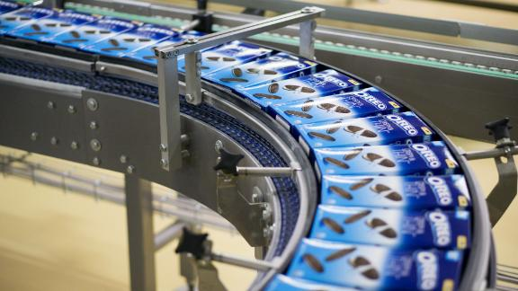 Packets of Oreo biscuits move along a conveyor belt on the production line at the Trostyanets confectionery plant, operated by Mondelez International Inc., in Trostyanets, Ukraine, on Thursday, April 6, 2017. Mondelez International Inc. bucked Russias recession to expand retail sales there by a double-digit percentage last year after starting to produce Oreo cookies as well as sweets blending chocolate and crackers, the companys regional manager said. Photographer: Vincent Mundy/Bloomberg via Getty Images