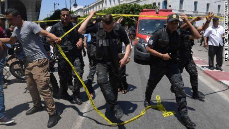 Tunisian police are working on the site of one of Thursday's attacks.