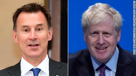 LEFT: LONDON, ENGLAND - JUNE 21: Conservative leadership candidate, Jeremy Hunt leaves a Local Government Association meeting in Westminster on June 21, 2019 in London, England. Jeremy Hunt finished in second place on 77 votes, as Boris Johnson topped yesterday's Conservative leadership ballot with 160 votes. Johnson and Hunt will now campaign to party members prior to a final ballot, the result of which will be announced during the week of 22 July. (Photo by Leon Neal/Getty Images)RIGHT: BIRMINGHAM, ENGLAND - JUNE 22: Conservative leadership candidate, Boris Johnson attends the first hustings on June 22, 2019 in Birmingham, England. Johnson and Hunt are now campaigning prior to a final ballot which will be decided by party members, the result of which will then be announced during the week of 22 July. (Photo by Christopher Furlong/Getty Images)