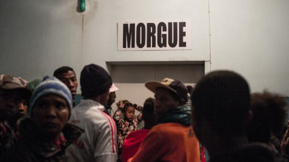 People wait outside the morgue where victims were taken after the incident in the capital, Antananarivo in Madagascar on June 26, 2019.