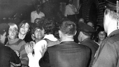 The crowd attempts to impede police arrests outside the Stonewall Inn on June 28, 1969.