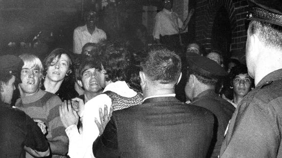 UNITED STATES - JUNE 28:  Stonewall Inn nightclub raid. Crowd attempts to impede police arrests outside the Stonewall Inn on Christopher Street in Greenwich Village.  (Photo by NY Daily News Archive via Getty Images)