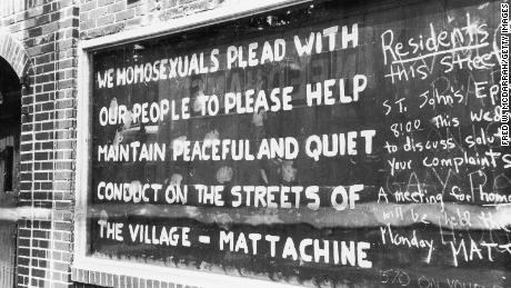 By the third day of the riots, messages filled a boarded-up window of the Stonewall Inn.
