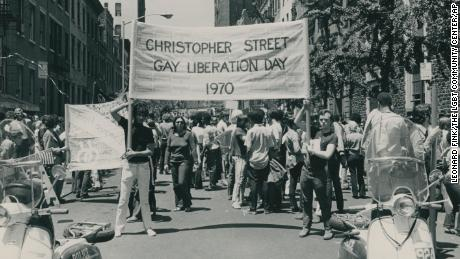Gay rights supporters rally on the first anniversary of the Stonewall riots.