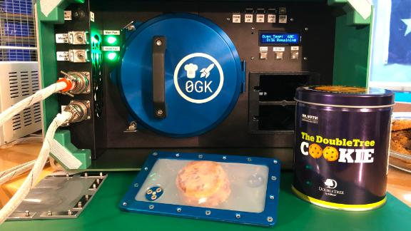The Zero G Kitchen space oven and a tin of DoubleTree by Hilton chocolate chip cookies were sent up to the International Space Station.