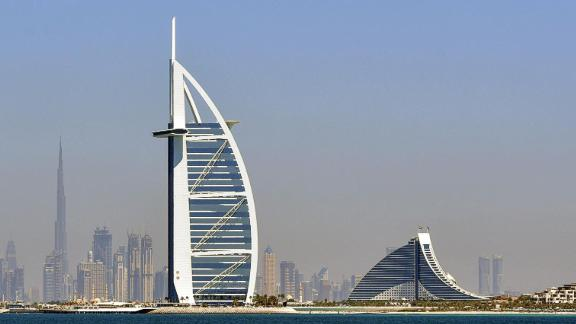 A picture taken on March 14, 2018 shows the skyline of Dubai with the Burj al-Arab (C-R) in the foreground and Burj Khalifa (C-L) in the background. / AFP PHOTO / GIUSEPPE CACACE        (Photo credit should read GIUSEPPE CACACE/AFP/Getty Images)