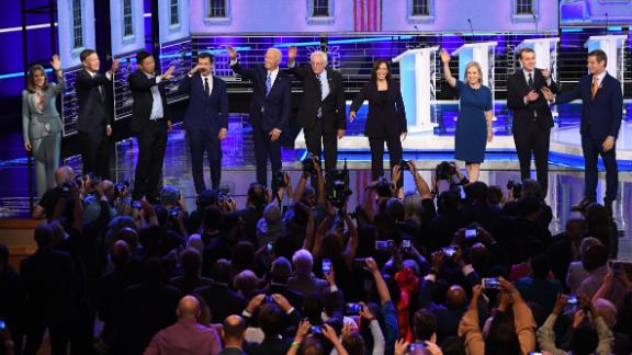 Ten presidential candidates take the stage for a Democratic debate in Miami on Thursday, June 27. The candidates, from left, are author Marianne Williamson; former Colorado Gov. John Hickenlooper; businessman Andrew Yang; South Bend, Indiana, Mayor Pete Buttigieg; former Vice President Joe Biden; US Sen. Bernie Sanders; US Sen. Kamala Harris; US Sen. Kirsten Gillibrand; US Sen. Michael Bennet; and US Rep. Eric Swalwell.