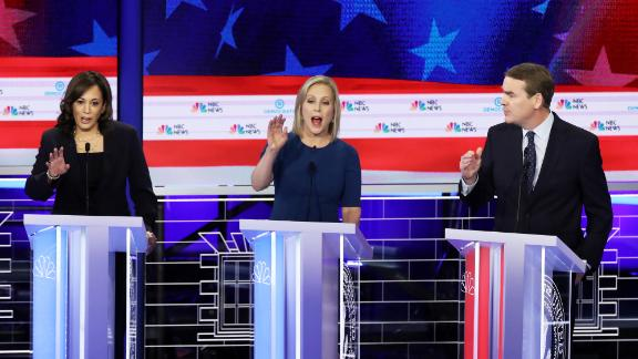 From left, Harris, Gillibrand and Bennet all try to speak at once during an early question on Thursday.
