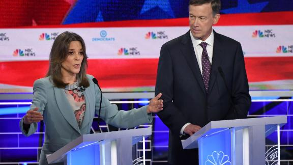Democratic presidential hopefuls US author and writer Marianne Williamson (L) and Former Governor of Colorado John Hickenlooper (R) participate in the second Democratic primary debate of the 2020 presidential campaign season hosted by NBC News at the Adrienne Arsht Center for the Performing Arts in Miami, Florida, June 27, 2019. - The candidates raised their hands in approval when asked if their health care for all plan would cover undocumented immigrants. (Photo by SAUL LOEB / AFP)        (Photo credit should read SAUL LOEB/AFP/Getty Images)