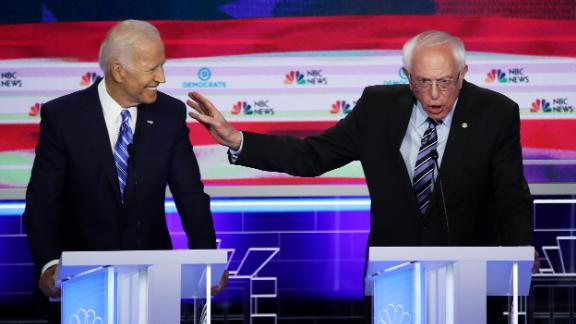 Sanders speaks next to former Vice President Joe Biden at the first Democratic debates in June 2019.
