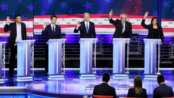 MIAMI, FLORIDA - JUNE 27: Democratic presidential candidates (L-R) former tech executive Andrew Yang, South Bend, Indiana Mayor Pete Buttigieg, former Vice President Joe Biden, Sen. Bernie Sanders (I-VT) and Sen. Kamala Harris (D-CA) raise their hands during the second night of the first Democratic presidential debate on June 27, 2019 in Miami, Florida.  A field of 20 Democratic presidential candidates was split into two groups of 10 for the first debate of the 2020 election, taking place over two nights at Knight Concert Hall of the Adrienne Arsht Center for the Performing Arts of Miami-Dade County, hosted by NBC News, MSNBC, and Telemundo. (Photo by Drew Angerer/Getty Images)