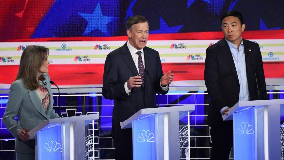 Democratic presidential hopefuls (L-R) US author and writer Marianne Williamson, Former Governor of Colorado John Hickenlooper and US entrepreneur Andrew Yang  speak in the second Democratic primary debate of the 2020 presidential campaign season hosted by NBC News at the Adrienne Arsht Center for the Performing Arts in Miami, Florida, June 27, 2019. (Photo by SAUL LOEB / AFP)        (Photo credit should read SAUL LOEB/AFP/Getty Images)