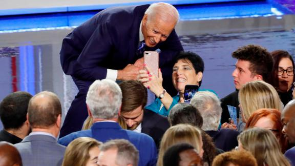 Biden poses for a selfie after the debate.
