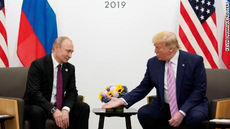 Russia's President Vladimir Putin and US President Donald Trump talk during a bilateral meeting at the G20 leaders summit in Osaka, Japan, June 28, 2019.