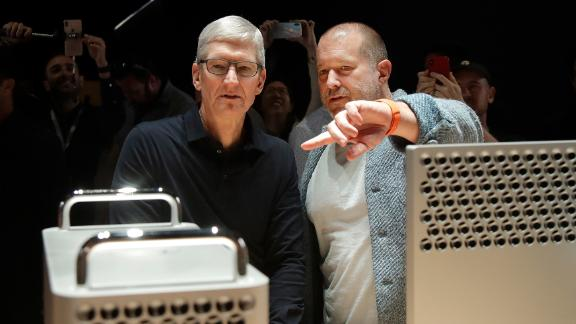Apple CEO Tim Cook, left, and chief design officer Jonathan Ive look at the Mac Pro in the display room at the Apple Worldwide Developers Conference in San Jose, Calif.